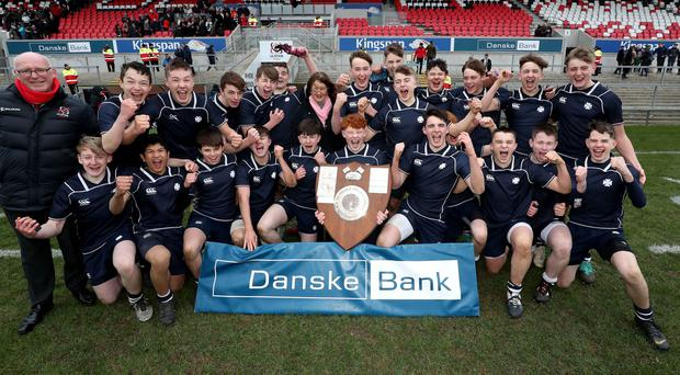 Danske Bank's Carol Wilson with the Danske Bank Medallion Shield winners Methodist College after they defeated Ballymena Academy in Tuesday's final at the Kingspan Stadium.