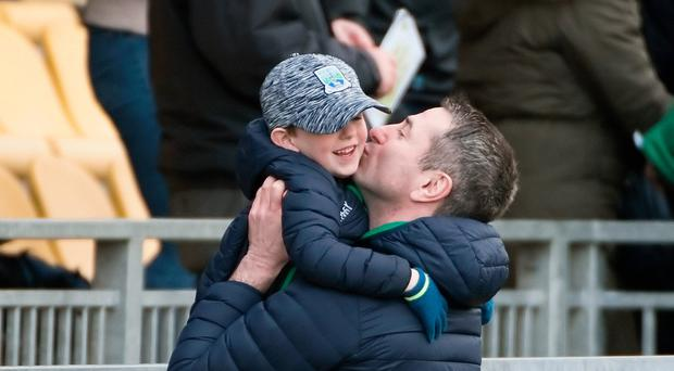 Child's play: Rory Gallagher celebrates with his son Sean following Fermanagh's win over Donegal