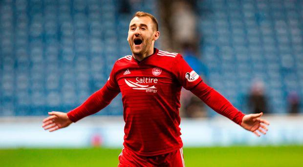 Flying start: Niall McGinn wheels away after netting early on