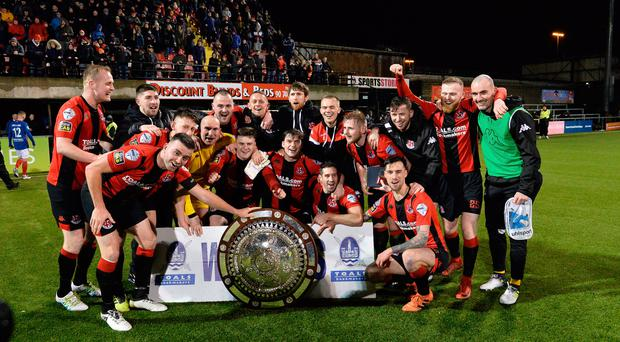 Blowing hot: victorious Crusaders show off the Shield