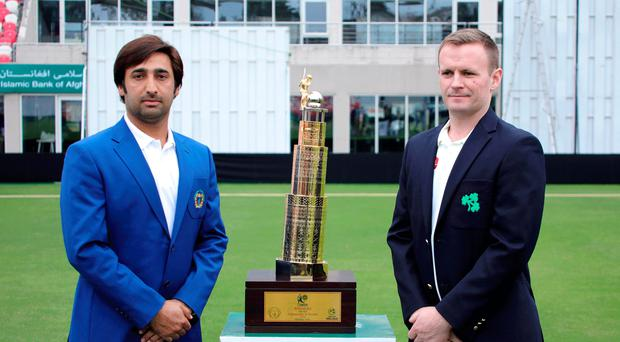 Captains' call: Asghar Afghan and William Porterfield with the Test trophy