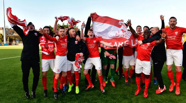On the up: Larne's players get the party started at Inver Park on Saturday