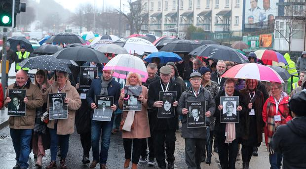 Families of those died march through the Bogside in Londonderry, Northern Ireland, ahead of the announcement as to whether 17 former British soldiers and two former members of the Official IRA will be prosecuted in connection with the events of Bloody Sunday in the city in January 1972.