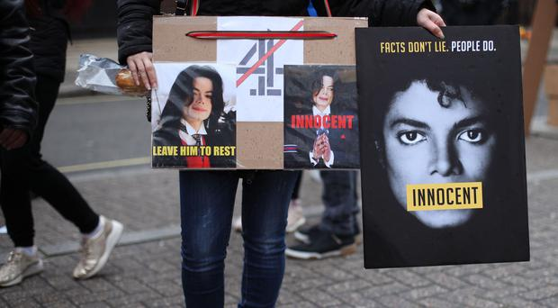 Transport for London is to remove Michael Jackson 'Innocent' posters from all London buses (Yui Mok/PA)