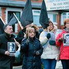 People gather in west Belfast to show their support for the Bloody Sunday families