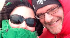 Kerry McLean weathering the storm on a day out with her husband Ralph