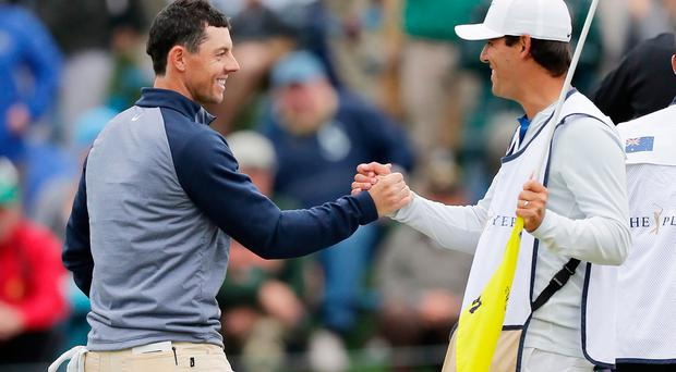Rory McIlroy celebrates his victory at The Players Championship with caddie Harry Diamond.
