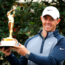 Golden glory: Rory McIlroy with the Players Championship trophy in Florida last night
