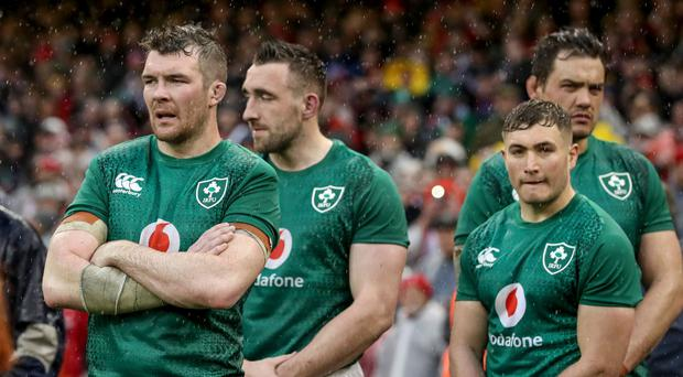 Low point: Ireland's Peter O'Mahony and Jordan Larmour show their disappointment after the defeat to Wales