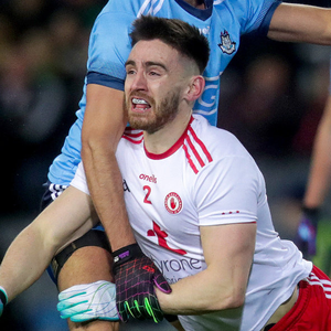 Closed down: Tyrone's Padraig Hennessy is tackled by Cian O'Sullivan of Dublin