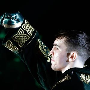 Michael Conlan gestures to fans before stepping into the ring for a featherweight boxing match against Mexico's Ruben Garcia Hernandez on Sunday, March 17, 2019, in New York. Conlan won the fight. (AP Photo/Frank Franklin II)