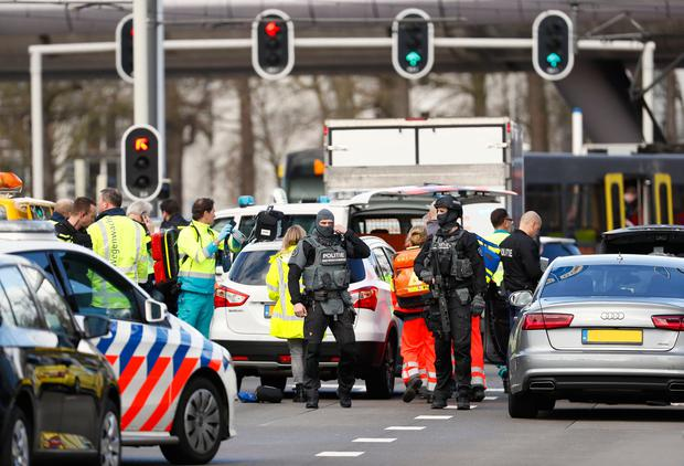 Emergency services attend the scene of a shooting in Utrecht, Netherlands, Monday March 18, 2019. Police in the central Dutch city of Utrecht say on Twitter that