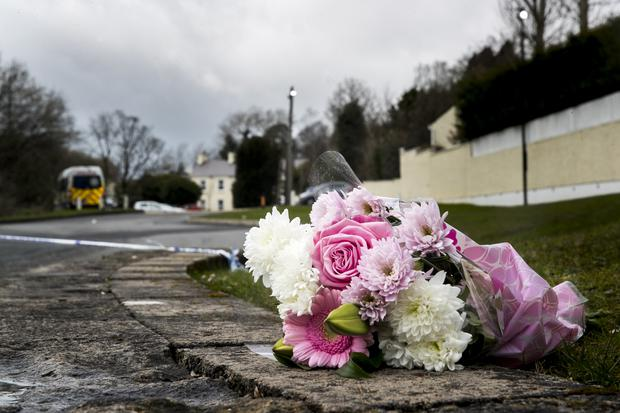 A floral tribute near the Greenvale Hotel (Liam McBurney/PA)