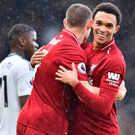 Flying high: Trent Alexander-Arnold celebrates victory against Fulham