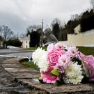 Flowers outside the Greenvale Hotel in Cookstown, Co Tyrone, in Northern Ireland where three young people have died at a party that was being hosted at the hotel on St Patrick's Day evening.