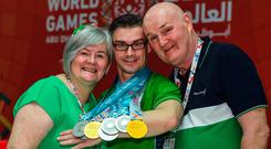 Medal haul: Patrick Quinlivan (centre) with the seven medals he's won at the Special Olympics