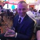 Glen O'Rorke, from Bangor, with his Paramedic of the Year Award. Credit: NIAS