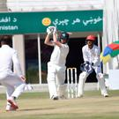 Big hit: Tim Murtagh scores a boundary in India