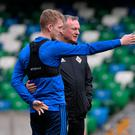 Lining it up: Northern Ireland boss Michael O'Neill and George Saville talk tactics