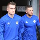 Northern Ireland's Steven Davis and Conor Washington prepare for training at Windsor Park.
