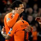 The Netherlands' Virgil van Dijk (L) celebrates with Memphis Depay.