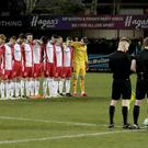 Linfield's players stand in respect of three local teenagers who died at an incident in Cookstown on St Patrick's night. Photo by David Maginnis/Pacemaker Press