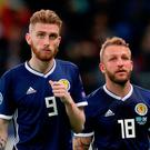 New low: Scotland duo Oliver McBurnie and Johnny Russell