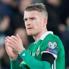 Great applause: Steven Davis was impressed with Bailey Peacock-Farrell's crucial save, minutes before the captain netted a penalty against Estonia