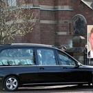 The hearse carrying the coffin of Reece Leeman arrives at St Mark's Church for the funeral in east Belfast. The 21-year-old was murdered on the 15th March. Pic by Peter Morrison