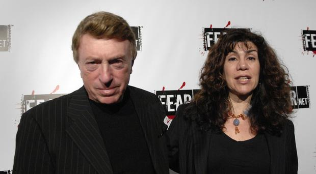 Larry Cohen, pictured with his wife, has died (Phil McCarten/AP)