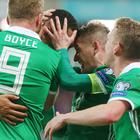 Northern Ireland captain Steven Davis celebrates with winning goalscorer Josh Magennis.