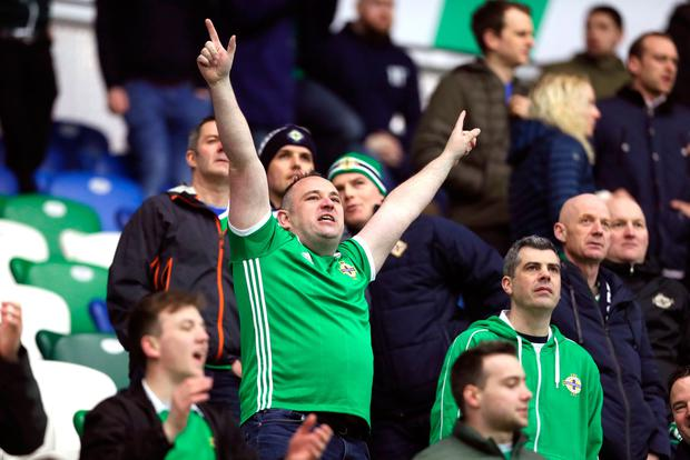 A Northern Ireland fan helps lift the atmosphere at Windsor Park.