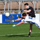 Pressure on: Cavan's Niall Murray aims to stop Dublin ace Bernard Brogan at Kingspan Breffni Park yesterday