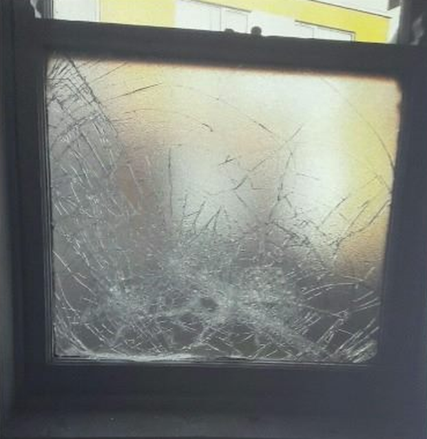 A smashed window at the church. Credit: PSNI