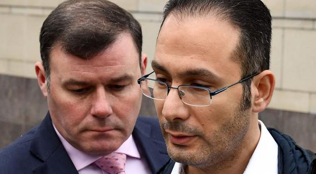 Murder victim Hazen Ahmed Ghrier's brother Rami leaves court with PSNI Detective Chief Inspector Peter Montgomery following the sentencing of Callin Wilson for the killing. Pic Alan Lewis
