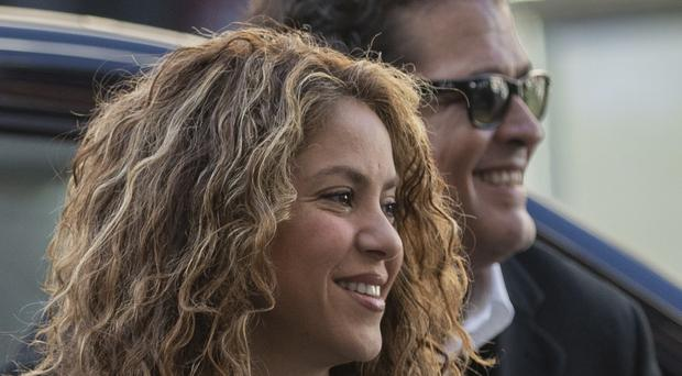 Colombian singers Shakira, left, and Carlos Vives (Bernat Armague/AP)