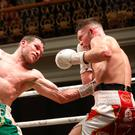 Pointing way: Luke Keeler lands a blow on Conrad Cummings during his victory at the Ulster Hall