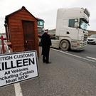 A mock customs post is put up by Border Communities Against Brexit protesters on Old Belfast Road in Carrickcarnon on the northern side of the Irish border, between Newry and Dundalk.
