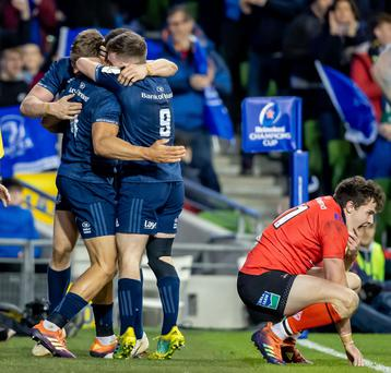 Leinster celebrate their second try while Ulster's Jacob Stockdale is crestfallen.