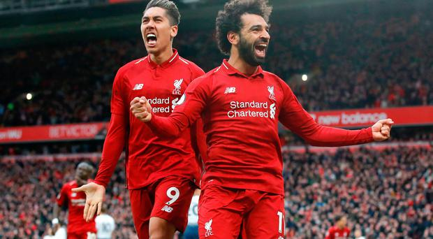 Late twist: Liverpool's Mohamed Sala and Roberto Firmino celebrate after Toby Alderweireld scored an own goal