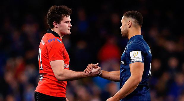 Game gone: Jacob Stockdale shakes hands with Leinster's Adam Byrne