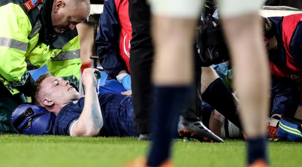 Leinster's Dan Leavy receives treatment during the Champions Cup quarter-final against Ulster.