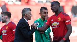 Close relationship: Ole Gunnar Solskjaer and Paul Pogba have a strong bond
