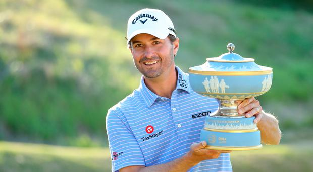 AUSTIN, TEXAS - MARCH 31: Kevin Kisner of the United States celebrates with the Walter Hagen Cup after defeating Matt Kuchar of the United States 3&2 during the final round of the World Golf Championships-Dell Technologies Match Play at Austin Country Club on March 31, 2019 in Austin, Texas. (Photo by Warren Little/Getty Images)