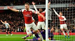 Arsenal's Welsh midfielder Aaron Ramsey (L) celebrates after scoring, but the goal was disallowed, during the English Premier League football match between Arsenal and Newcastle United at the Emirates Stadium in London on April 1, 2019. (Photo by Glyn KIRK / AFP) / RESTRICTED TO EDITORIAL USE. No use with unauthorized audio, video, data, fixture lists, club/league logos or 'live' services. Online in-match use limited to 120 images. An additional 40 images may be used in extra time. No video emulation. Social media in-match use limited to 120 images. An additional 40 images may be used in extra time. No use in betting publications, games or single club/league/player publications. / GLYN KIRK/AFP/Getty Images