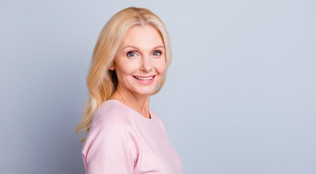 Cream lotion balm mask salon purity procedure people collagen freshness concept. Close up portrait of beautiful pretty cute lovely mature lady looking at camera isolated on gray background copy-space