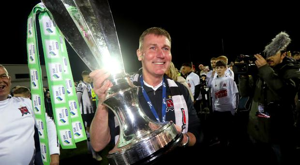 Dundalk manager Stephen Kenny celebrates with the SSE Airtricity Premier Division trophy.