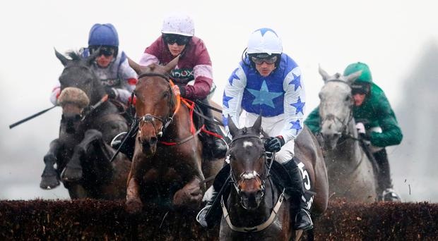 In front: Ruby Walsh and Kemboy clear the last