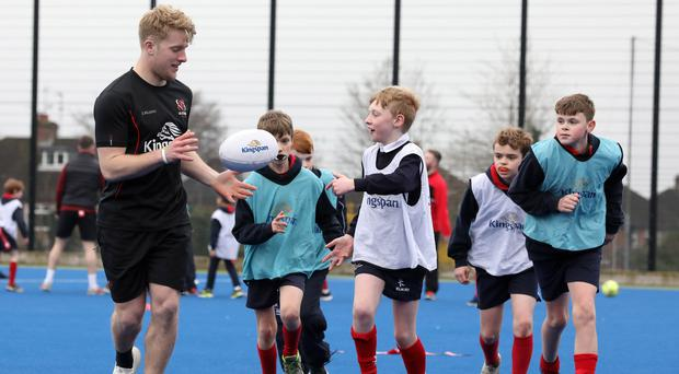 Learning curve: Rob Lyttle passes on some tips to these young Wallace High Preparatory School stars of the future during the week