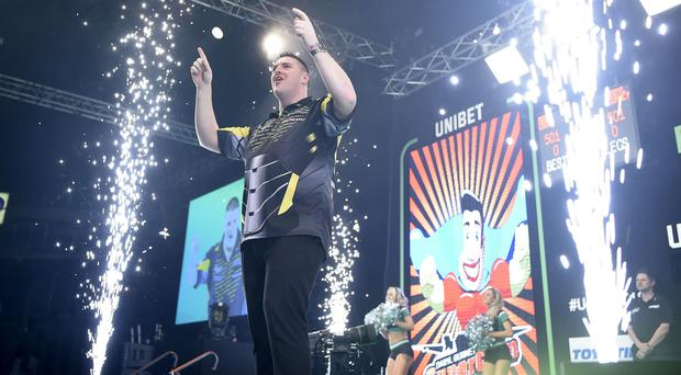 Fans' favourite: Daryl Gurney hails the huge home crowd at the SSE Arena in Belfast last night
